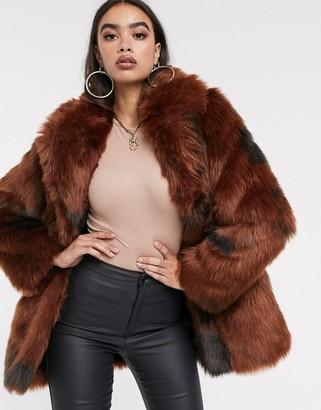 Asos DESIGN cow print faux fur coat