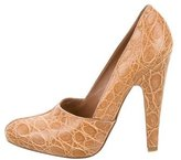 Alaia Round-Toe Crocodile Pumps