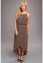 uncategorized  Who made Ashley Greenes halter print maxi dress, green tassle handbag, black sandals, and iphone case?