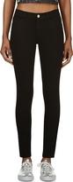 miranda kerr  Who made  Miranda Kerrs black sunglasses, tote handbag, belt, skinny jeans, and ankle boots?