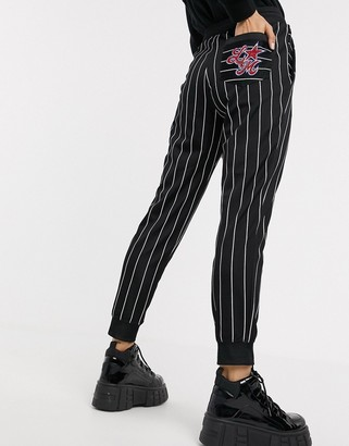 Love Moschino star embroidered logo stripe joggers