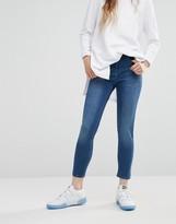 WÅVEN Asa Mid Rise Skinny Jean in Blue