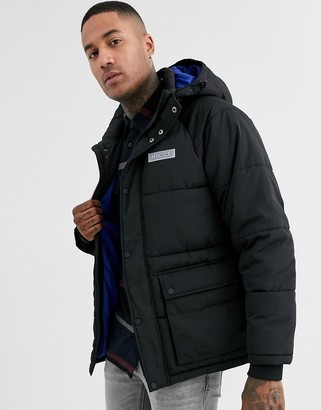 Nicce long puffer coat with hood in black
