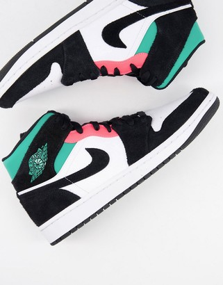 Jordan Nike Air 1 Mid trainers in white and green