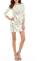 B. Darlin Sequin Scroll Pattern Lace-Up Back Sheath Dress