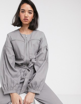 Asos Design DESIGN zip front boiler jumpsuit with slouchy puff sleeve-Green