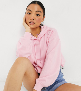ASOS DESIGN Petite boxy hoodie with batwing sleeves in soft pink