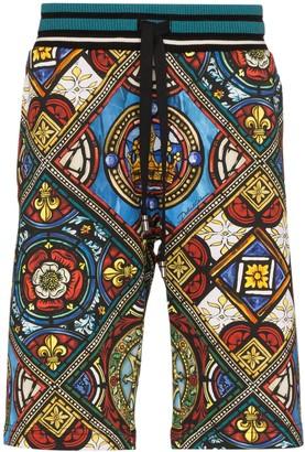 Dolce & Gabbana Kings age print track shorts