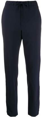 Closed high-waisted slim-fit trousers