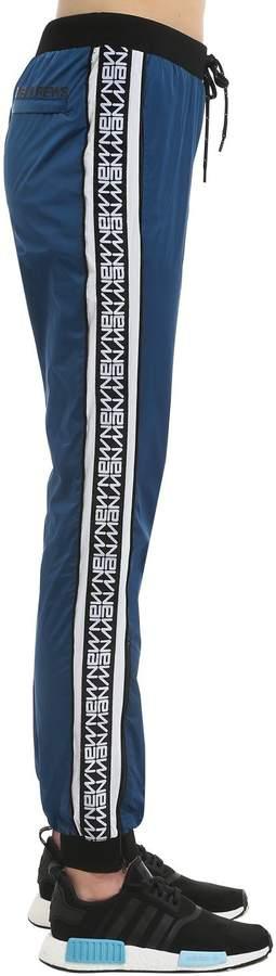 Andrea Crews New Man Logo Side Bands Track Pants