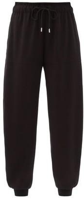 Chloé Drawstring-waist Pegged Satin-back Crepe Trousers - Black