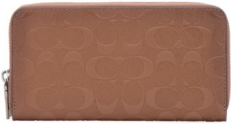 Coach Monogram Embossed Zipped Wallet