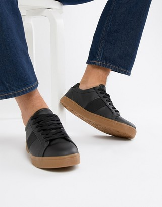 Asos DESIGN sneakers in black with gum sole