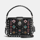 Coach Page Crossbody In Glovetanned Leather With All Over Western Rivets
