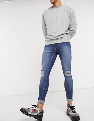 Criminal Damage destroyed skinny jeans in blue