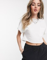 Bershka cropped tee with pocket detail in white