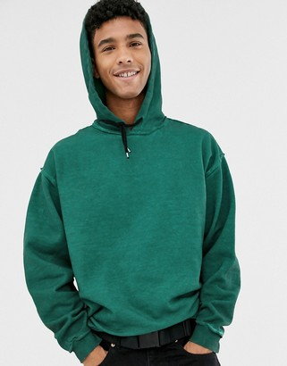 Asos Design DESIGN oversized hoodie in green oil wash with popped out seams