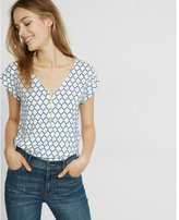 Express blue and white quatrefoil zip front blouse