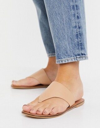 ASOS DESIGN Folly leather toe thong sandals in beige