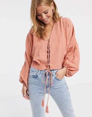 Asos Design DESIGN long sleeve top in natural crinkle with tie front detail-Pink