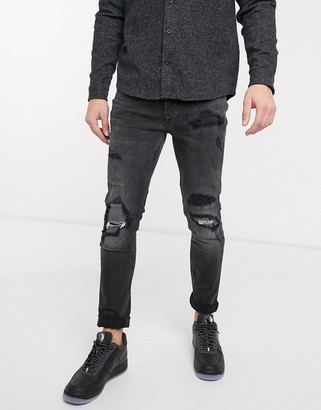 Topman organic skinny jeans with extreme rips in washed black