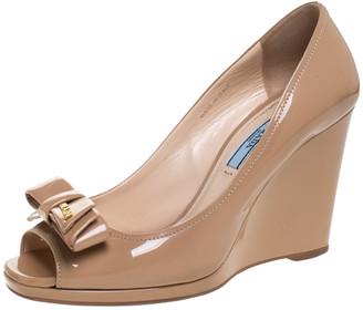 Prada Nude Beige Patent Leather Bow Peep Toe Wedge Pumps Size 37.5