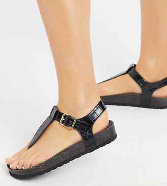 London Rebel wide fit t bar flat sandals in black croc