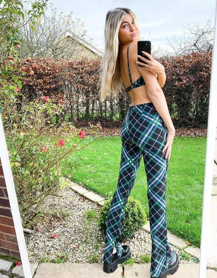 Thumbnail for your product : Collusion slim flares with zip hem in black & green plaid co