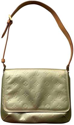 Louis Vuitton Thompson Gold Patent leather Handbags