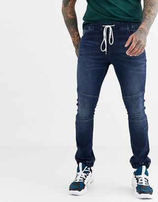 Asos Design DESIGN super skinny jogger jeans with biker details in dark wash blue