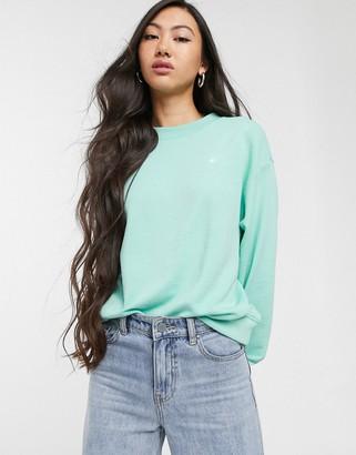 Monki Nana organic cotton sweatshirt with rainbow embroidery in green