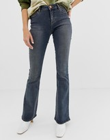 Asos Design DESIGN Mid rise flare jeans in dark stone wash blue