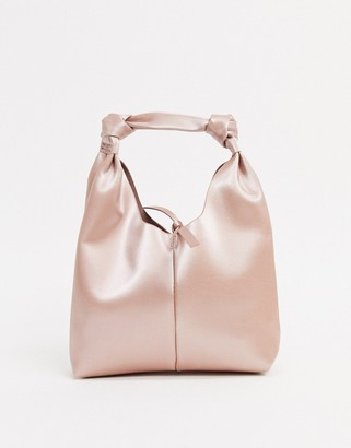 ASOS DESIGN mini clutch bag with knot strap in blush bonded satin
