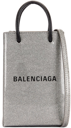 Balenciaga Glitter Shopping Phone on Strap Bag in Silver | FWRD