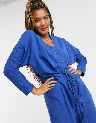 ASOS DESIGN lounge jersey button front long sleeve tie waist jumpsuit in blue