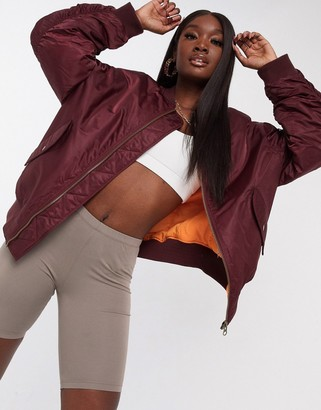 ASOS DESIGN oversized bomber jacket with sleeve detail in oxblood