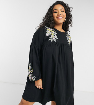 ASOS DESIGN Curve mini smock dress with long sleeves in black with shoulder yellow floral embroidery