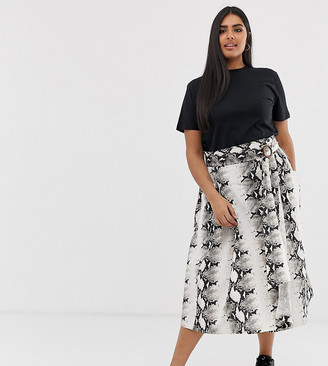 Asos DESIGN Curve wrap midi skirt with wooden buckle and pockets in snake print