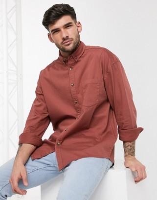 ASOS DESIGN 90s oversized organic denim shirt in rust