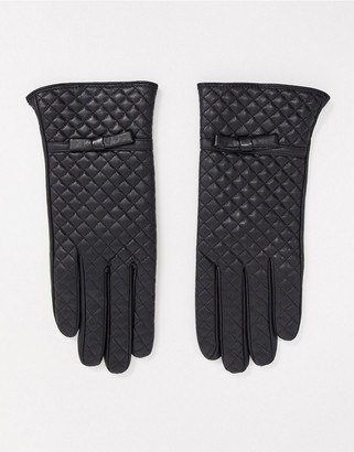Barneys New York real leather quilted gloves in black