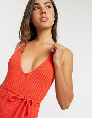 Topshop crinkle one-piece with belt detail in red