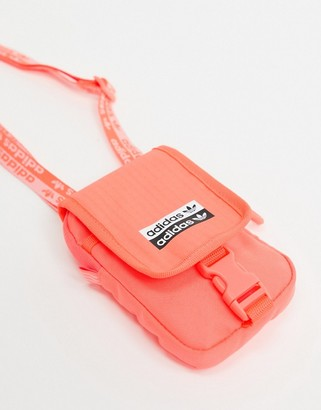 adidas RYV map bag in signal coral