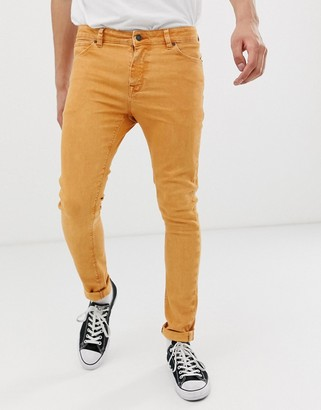 ASOS DESIGN super skinny jeans in orange