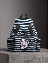 Burberry The Large Rucksack In Striped Nylon With Pallas Helmet Motif, Blue