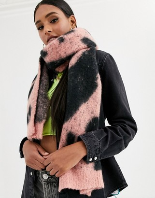 ASOS DESIGN cow knit oversized long scarf in black and pink