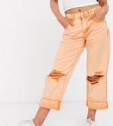 Asos DESIGN Petite low slung carpenter jeans with extreme rips in orange