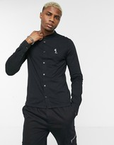 Religion grandad collar shirt with praying skeleton in black