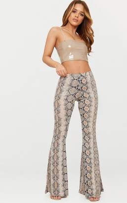 PrettyLittleThing Petite Stone Snake Print Flared Trousers