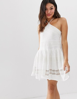 Asos Design DESIGN halter neck drop waist mini sundress with lace trim-White