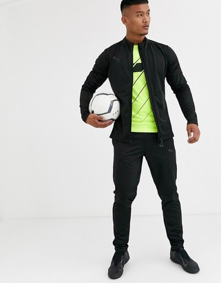 Puma Football tracksuit in black exclusive to ASOS